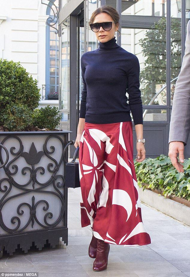 Victoria Beckham chic: After gracing a special Vogue Spain dinner in the wake of her breathtaking cover on the magazine. Navy turtleneck sweater, red and white print long skirt, boots, sunglasses. Jan 2018.