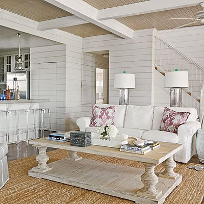 White horizontal plank walls, natural wood plank ceiling, white ceiling beams, woven jute rug