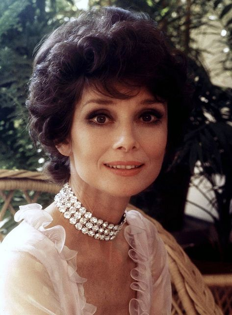 In March 1976, Signora Audrey Hepburn Dotti photographed by Elisabetta Catalano at her apartment in Rome (Italy), in the Parioli area (on Via di San Valentino). She is wearing a pink Valentino gown.