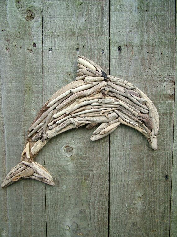 Natural Driftwood Dolphin    These individual and unique pieces of driftwood used to create this wonderful Dolphin have been gathered from the craggy beaches of South West Scotland. The beautiful contours within each piece depict the coastline, rich in wildlife and natural beauty. Every little piece of driftwood has been meticulously attached to a shaped wooden board to create a beautiful Dolphin ready to adorn your wall.    All of my creations are made from my heart and I endeavour to make…