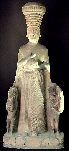 """""""The worship of Cybele was originally centered in Phrygia (Turkey), where she was known Kubaba or Kybele. The Romans formally adopted her worship in 204 BCE, when they brought a statue representing her from her main shrine in the Phrygian city of Pergamum back to Rome. This statue, from a site in Anatolia dating to the eighth or early seventh century BCE, depicts the Phrygian goddess with two youthful attendants playing a flute and harp."""""""