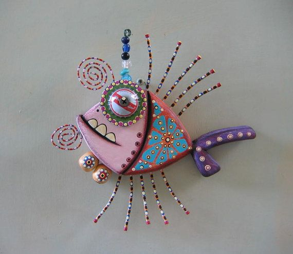 Original art work by Kerry Heath. This colorful water dweller was created from salvaged wood, found objects and acrylic paints. He is 7 long x