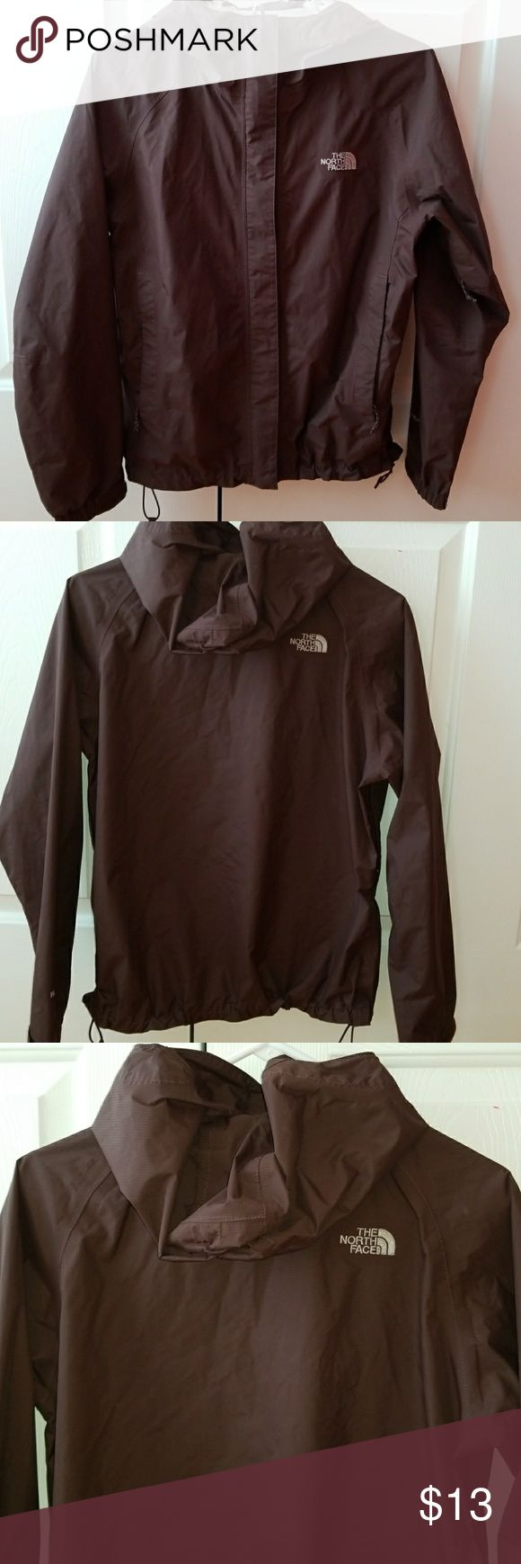 North Face Brown Windbreaker Jacket North Face Brown Windbreaker Jacket! Great jacket that matches with anything. Only issue is wear and tear on the inside of the hood just at the bottom! As seen in pictures.  Good condition. All zippers and velcro work. No damage on the outside!  Size S Exterior 100% Nylon North Face Jackets & Coats