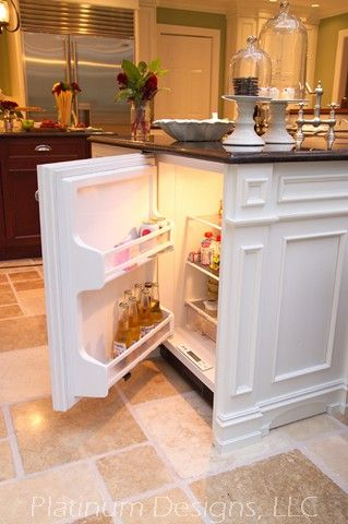 Mini-fridge built into island, for finished basement or for kid food in kitchen so it's at their level