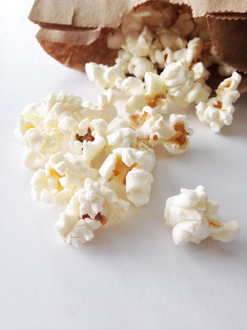 Brown Bag Popcorn (Garlic Parmesan) — 2 T. popcorn in a brown paper bag.  Microwave for 2 - 3 mins.  Open bag.  Pour in ingredients (oil, or butter, salt, cheese, whatever), shake to coat and eat.