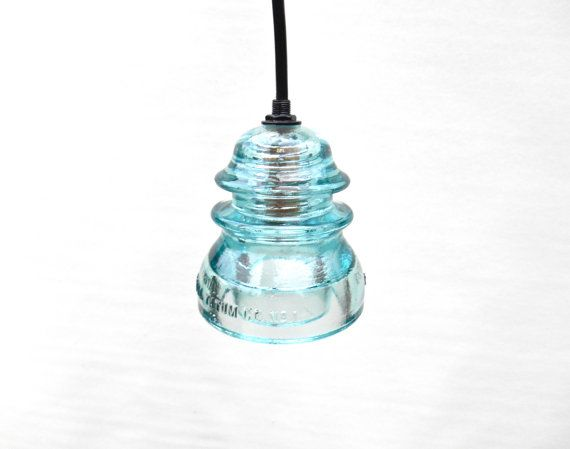 Thank you for supporting the ORIGINAL insulator lights of only the highest quality!    This insulator is gorgeous! More rare than the darker blue or clear, this insulator is much lighter, producing more light output when turned into a pendant light. If you order more than one, we will make sure they match.    Wired for installation or wired with a plug! Gorgeous in the kitchen, bedroom, bathroom, dining room, living room, hallways, or wherever else youd like to beautify and light. These…