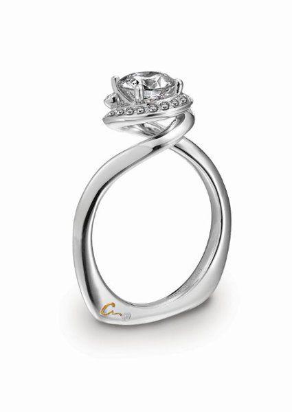 We love the swirl design on this platinum engagement ring! {Platinum Guild International}
