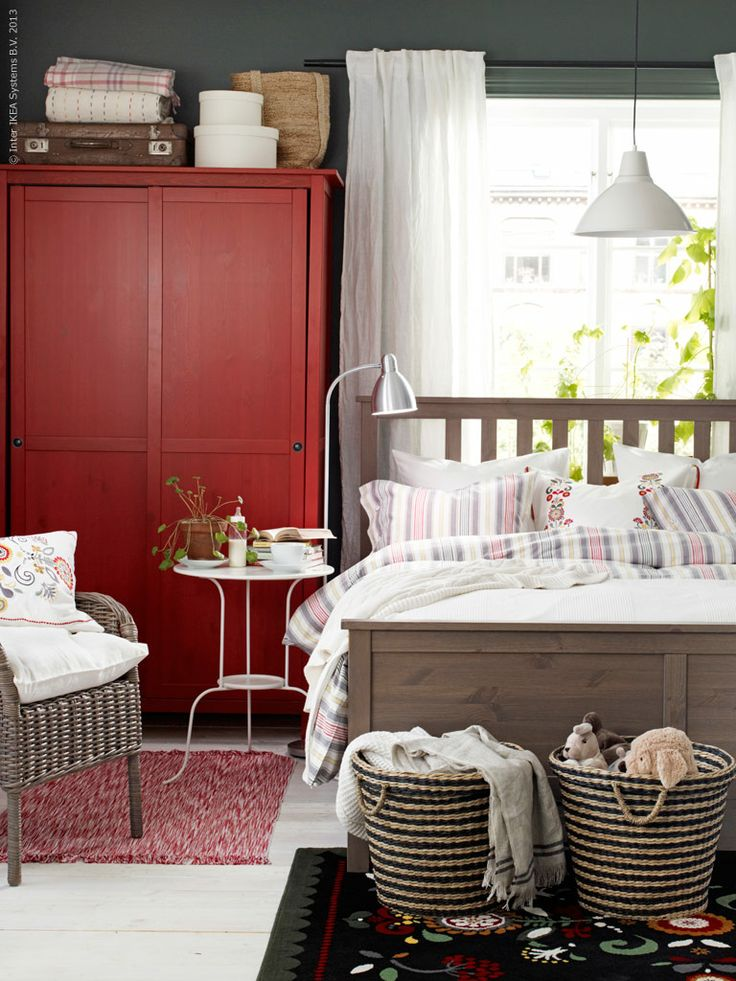 Hemnes bed gray brown, Byholma side chair, foto pendant over the bed. Sadly, the red Hemnes has been discontinued.