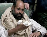"""Saif al-Islam Gaddafi,  son of the infamous, so called """"Tyrant Dictator"""" Muammar Gaddafi,  be removed from his current Libyan rebel captors, who intend to try  him for war crimes, and brought to the International Criminal Court  instead for his pending trial. No proof has been given as to these  accusations and the ongoing postponement of the trial suggests the  opposition might be struggling to manifest such evidence."""