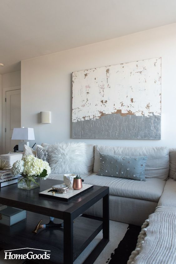 Tour @styleMBA's chic Arlington VA condo, that features a neutral living room and additional tips and tricks for a bedroom makeover. Designed and styled with the help of Homepolish and HomeGoods