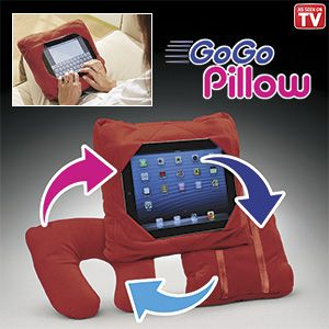 "Product # HC6437 - The most versatile pillow ever! Take it everywhere - this soft pillow is specially designed to function on any surface - wherever you are! The multi-slot design keeps any size tablet safe and secure. The dual stretch straps on the back allow the pillow to be mounted on the back of a headrest while traveling by car, or fold it into a travel pillow (15""L x 4-1/2""H x 12-3/4""W). Design allows for easy access to power cord and earpiece sockets. 12-1/2""-SQ. x 4-1/2""W.   $29.98"