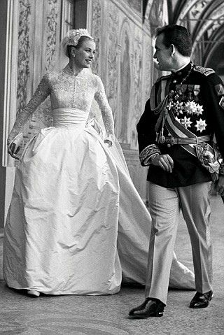 Grace Kelly.  Married April 19, 1956, Monaco, France.  Designed by Helen Rose, MGM.  I always thought the disciplined bodice, cummerbund, and structured skirt of this dress very much complemented Rainier's military uniform.
