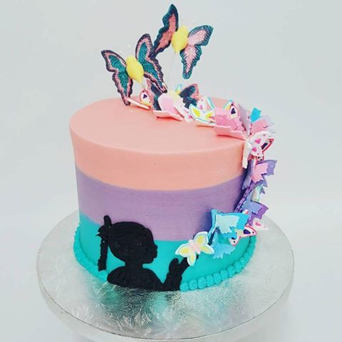 Three colour cake with hand painted butterflys