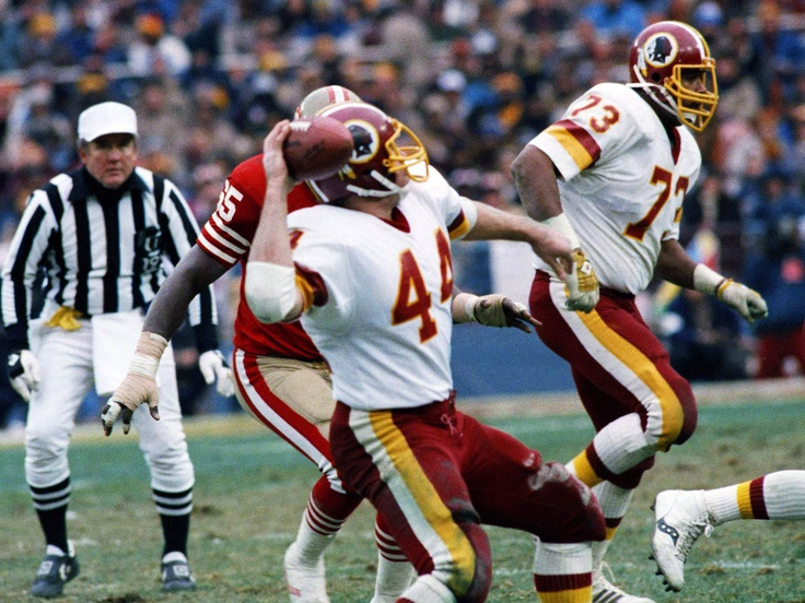 John Riggins attempting pass against 49ers. Redskins win