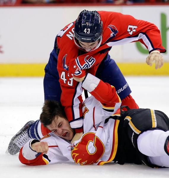 Washington Capitals right wing Tom Wilson (43) fights with Calgary Flames center Lance Bouma