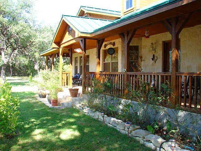 Best 25 hill country homes ideas on pinterest for Texas ranch house plans with porches