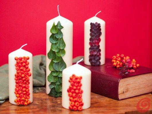 decorazioni autunnali: le candele decorate con bacche e foglie autunnali