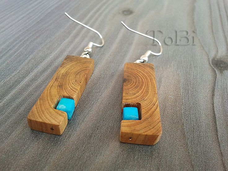 Wooden earrings by ToBicouple on Etsy. $15.00, via Etsy. [The use of the annual rings of the branch make this work]