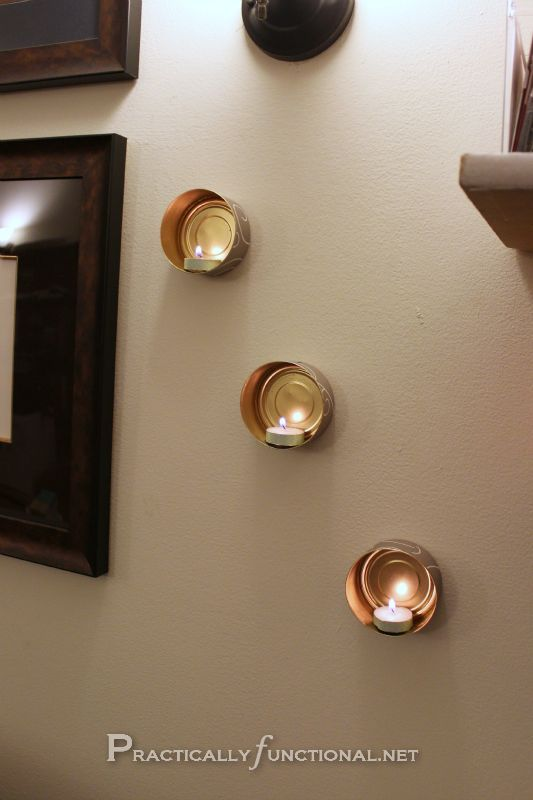 Recycle tin cans into cute wall mounted candle holders!>> would look awesome in bathroom