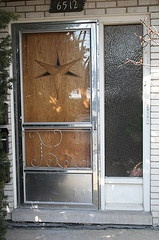 Aluminum screen doors. I still have one on my back door, not with the fancy scrolling though, just glass.