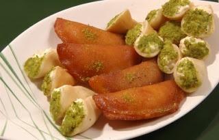 Ramadan Desserts  Kattayef ..Stuffed pancakes with honey and nuts- Egypt