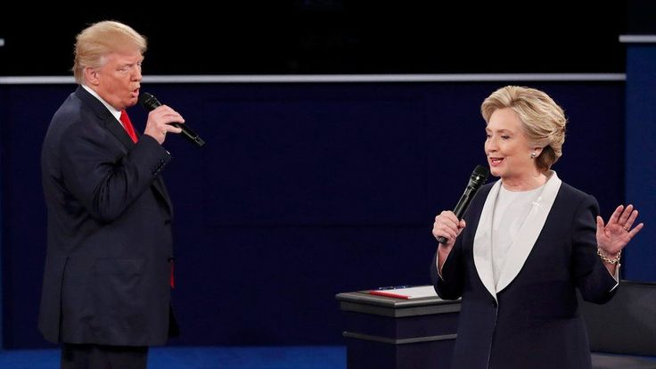 'You're the one that I want, ooh ooh ooh' Republican US presidential nominee Donald Trump and Democratic US presidential nominee Hillary Clinton speak during their presidential town hall debate at Washington University in St. Louis, Missouri