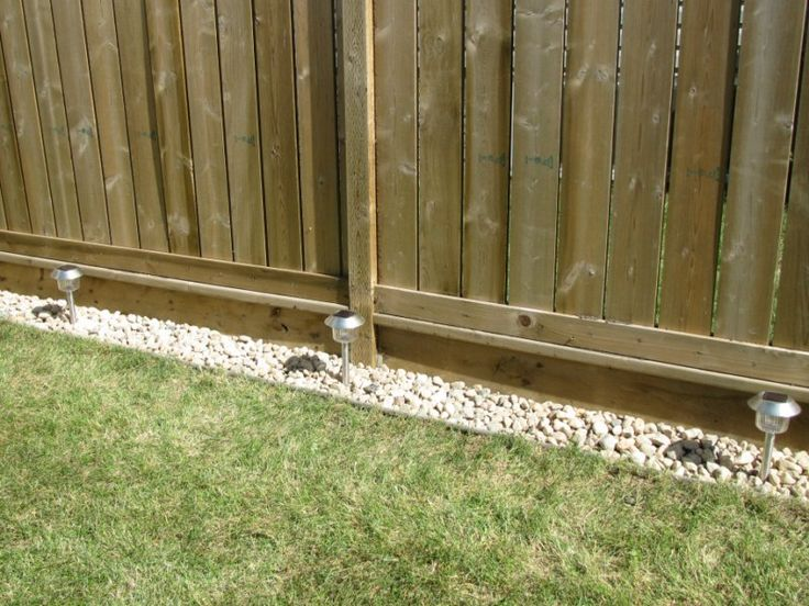 Kelly loves stuff rock border along the fence for the for Garden bed fence ideas
