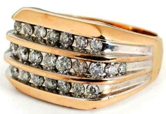 Elvis Presley's Three-Channel Diamond Ring.This ring went for the same $12,800 price as the previous one, but it seems to be a superior ring. It contains 25 full-cut diamonds totaling 1.25 cts. The band is 14k gold weighing 10 grams. The reason it didn't go for more is hinted in the auction website description. It says it was owned by Elvis, but makes no mention that he wore it. Because it came from the estate of his Vernon Presley, it seems like Elvis bought this ring to gift to his father