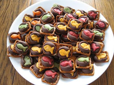 yummy sweet and salty treats! ...pretzels, kisses candy and Goldfish on top...AND if we do any kind of fish theme, these would be perfect! Silly, but also awesome!!!