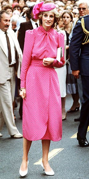 Princess Diana wearing a silk dress of fuchsia-pink w/ tiny white dots w/ a straight skirt, twisted neckline, and self belt.