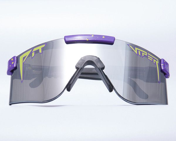 Did #TMNT inspire you as much as it did us? Can you imagine yourself swinging a bow-staff in these? The answer is yes. Obviously. The #Purple base with neon #green splatter and a logo to match will destroy above and below ground. #shades #sunglasses #pitviper