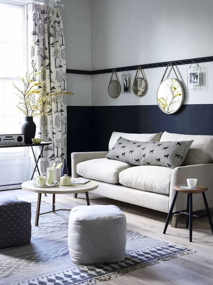 A peg rail and split colour on the walls take the place of an older-style picture rail. Pale ash flooring keeps the scheme light. Photography: Dan Duchars. Find more living room ideas at housebeautiful.co.uk