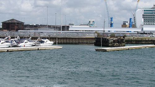 The entrance to Town Quay Marina in Southampton. Gap is between two wave breaking pontoons and close to Red Funnel High Speed Ferry.