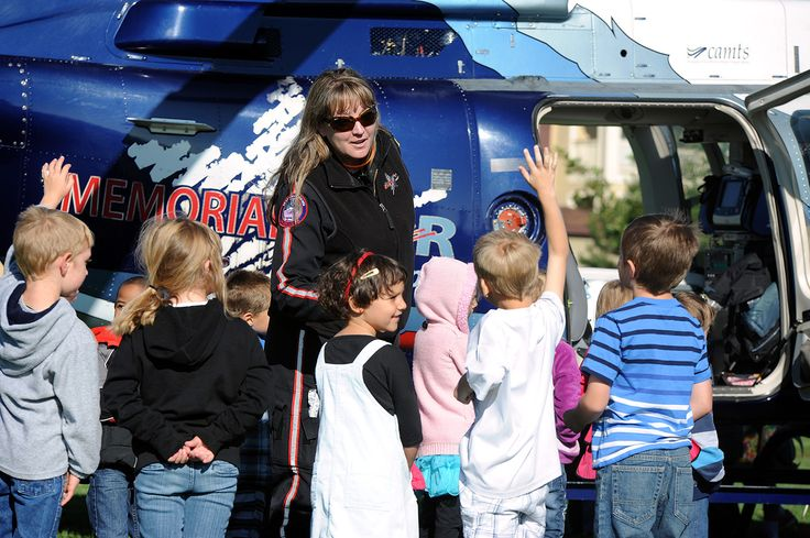 Diane Shaneyfelt, flight registered nurse, meets with students after landing in an air medical helicopter for Hero Day activities Sept. 11 at Odyssey Elementary School in District 49. A four-person team with Memorial Star, operated by Med-Trans, landed in a nearby park to greet lines of preschool through fifth grade students. The team typically flies within a 150-mile radius of Memorial Hospital in Colorado Springs.