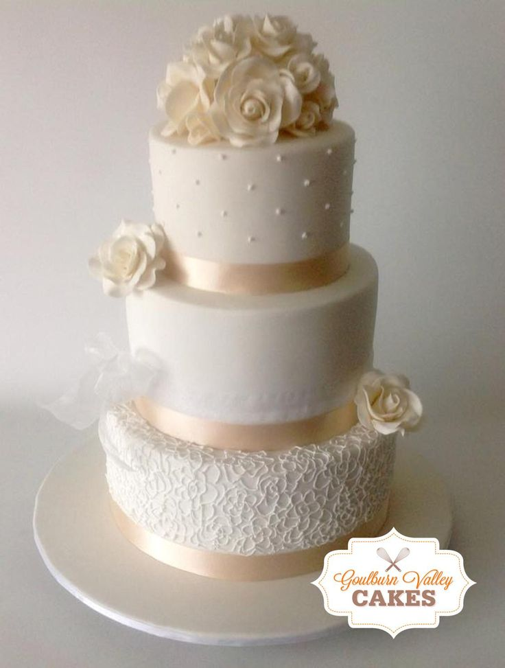 3 Tier Wedding Cake with roses piping and hand made roses