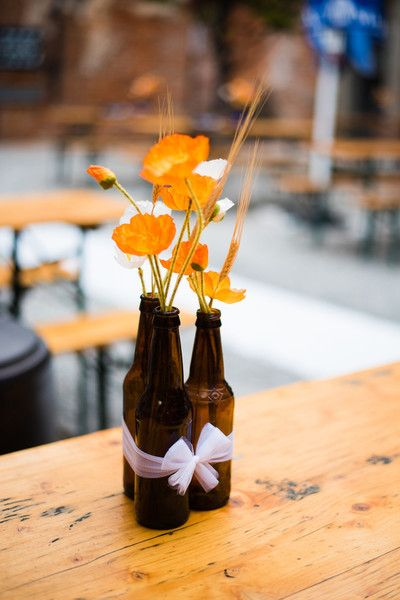 A unique idea - beer bottle centerpieces! Perfect for an #Oktoberfest wedding  {Nichole Meredith Photography}