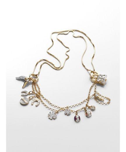 Collezione Diamond. Collana Smilla in oro giallo e piccoli charms tempestati di diamanti e rubini.