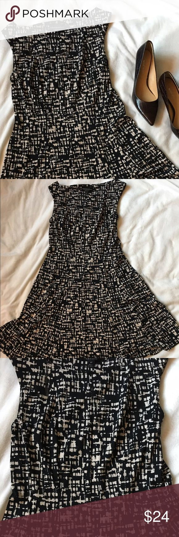 Black and White Print A-line Dress Preowned, form fitting dress with black and white print. The skirt does have a little a-line to it. Measurements are approximately: length 33 inches, chest 14.5 inches. Size 8 petite. No trades.  bundles of 3+ items qualify for 15% discount! Dresses