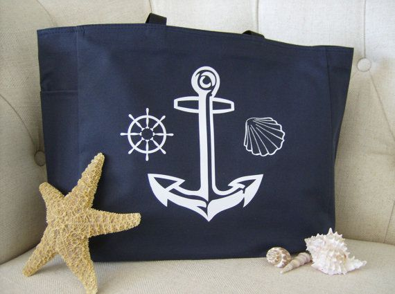 Nothing says I'm heading to the beach or hanging out on a yacht like this cool polyester nautical anchor tote! Anchors away!