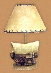 Old West covered wagon table lamp comes complete with wonderfully realistic, hand-painted details. Resin base is topped by a kraft hard-back paper shade with whip stitching.