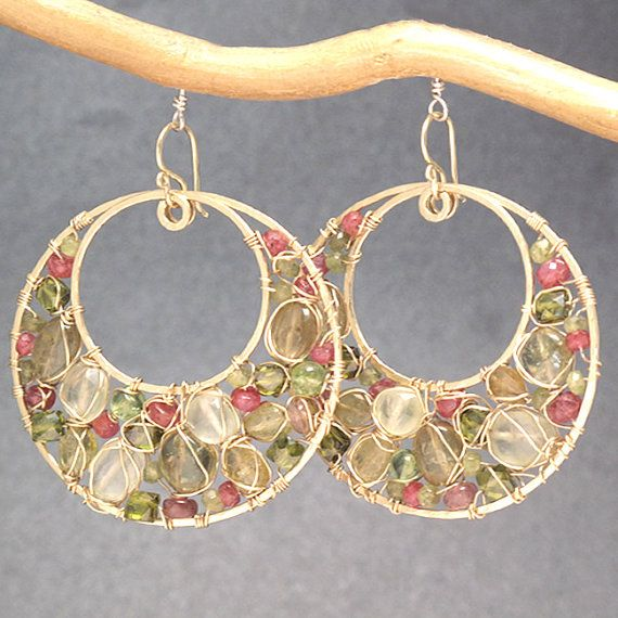 Hammered circles with green tourmaline, ruby, vessonite, and prehnite wrapped around inside, about 2-1/4 long. Available in 14k gold filled,