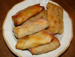 Baked Vegetarian Egg Rolls: egg roll wrappers, 1 small cabage or 1/2 of a large cabbage, 1 package broccoli slaw, soy sauce, salt, and pepper