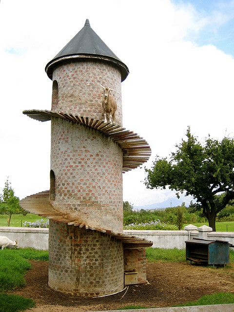 The Goat Tower - A Caprine Condominium    Image Credit  What do you do when you own a group of Swiss Mountain Goats but there isn't anywhere for them to climb? The answer that South African farmer Charles Back came up with was to create a domicile for his goats that would help keep them fit as well as giving them an altogether butter kind class of goat shed.
