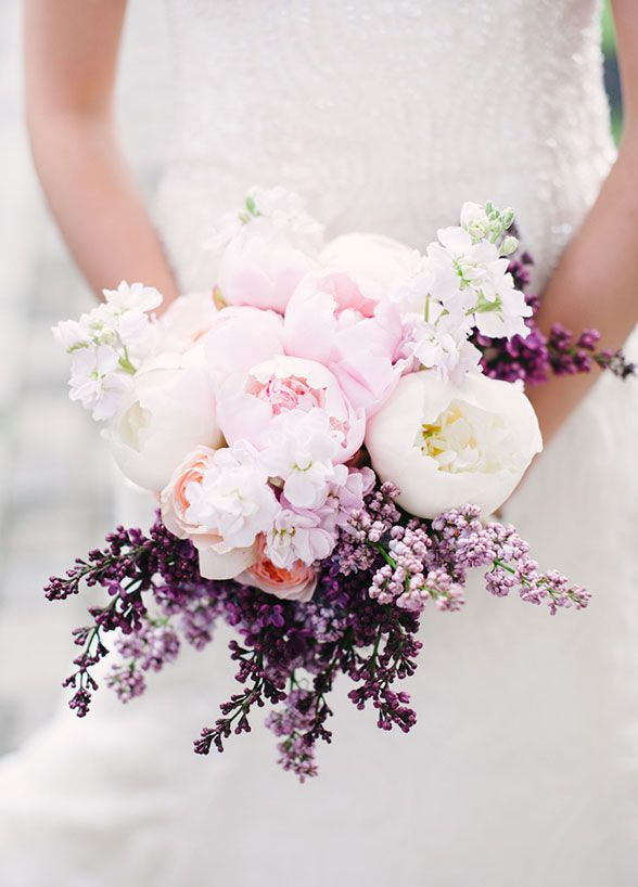 Soft pink peonies are accented with fragrant purple lilacs for a simply sweet floral arrangement.