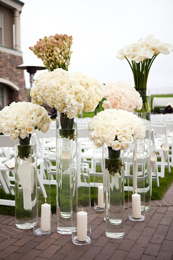 Flowers in tall votives