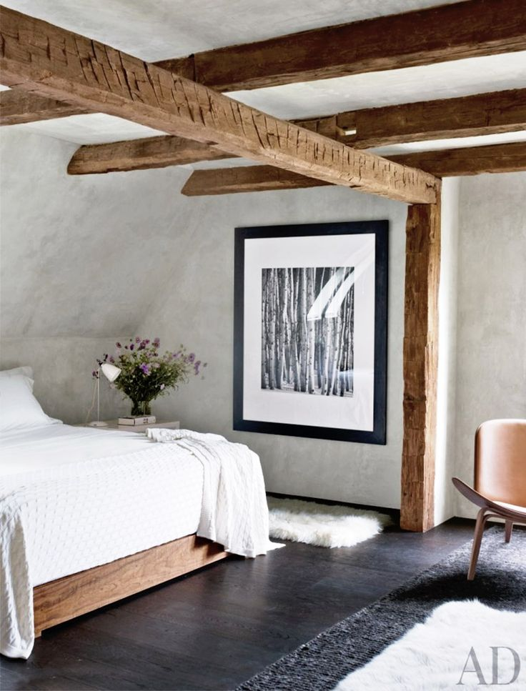 Rustic bedroom with exposed wood ceiling beams
