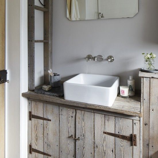 Washing machine ? Cupboard, washed wood and basin