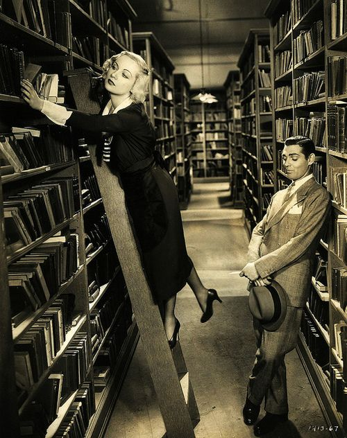 """Clark Gable admires Carole Lombard's legs in """"No Man Of Her Own"""" (1932)"""