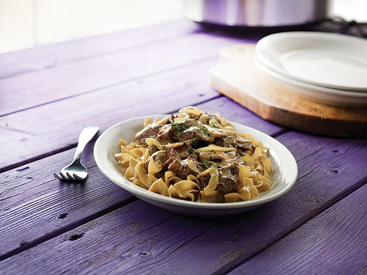 Hearty Beef Stroganoff. Classic beef Stroganoff is a Russian dish made by simmering strips of beef in a stew and swirling in velvety sour cream. Our slow-cooker version has all the flavor of the original recipe but with less fuss. Serve over whole-grain broad noodles or brown rice.