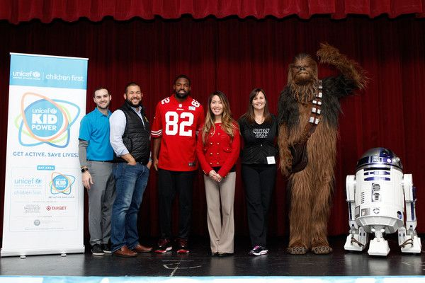 Torrey Smith Photos Photos - (L-R) Matt Meyersohn, U.S. Fund for UNICEF Managing Director, Sports & Kid Power Partnerships, Jason Trimiew, Vice President of the San Francisco Bay Area Super Bowl 50 Host Committee, San Francisco 49ers wide receiver Torrey Smith, Tiffani Mah, Store Team Leader at San Francisco West Target, Kayleen Walters, Vice President of Marketing at Lucasfilm R2D2 and Chewbacca attend UNICEF Kid Power Bay Area Celebration at De Marillac Academy on February 1, 2016 in S...